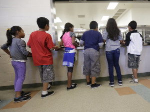 Detained immigrant children line up in the cafeteria at the Karnes County Residential Center, in Karnes City, Texas, a temporary home for immigrant women and children detained at the border. Eric Gay/AP npr.org